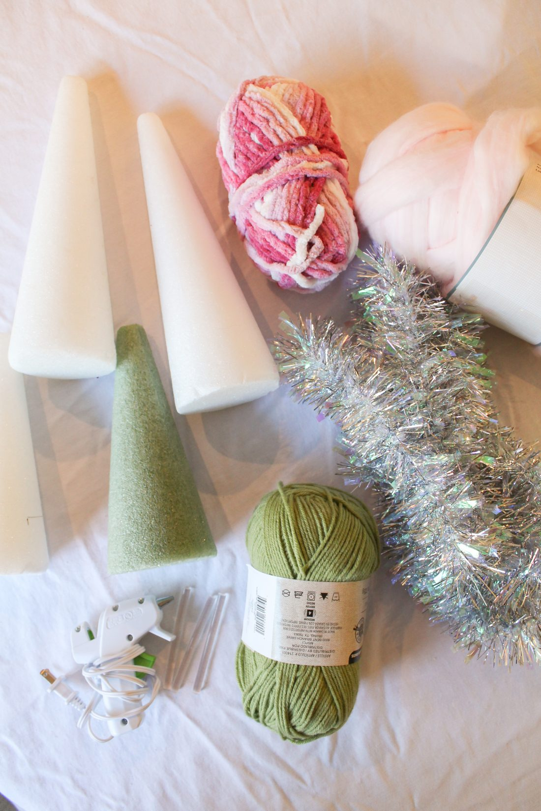 Do it yourself Christmas Cone Fabric Trees with chunky yarn and tinsel
